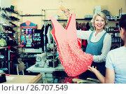 Купить «Tailor showing dress to customer», фото № 26707549, снято 19 июня 2019 г. (c) Яков Филимонов / Фотобанк Лори