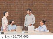 Купить «Business people at a desk talking against brick wall», фото № 26707665, снято 21 сентября 2019 г. (c) Wavebreak Media / Фотобанк Лори