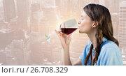 Купить «Woman tasting wine against blurry skyline», фото № 26708329, снято 17 июня 2019 г. (c) Wavebreak Media / Фотобанк Лори