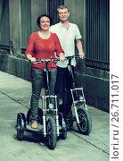 Mature couple staying with electric bikes. Стоковое фото, фотограф Яков Филимонов / Фотобанк Лори