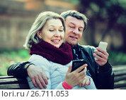 Купить «Couple with mobile phones», фото № 26711053, снято 22 сентября 2018 г. (c) Яков Филимонов / Фотобанк Лори