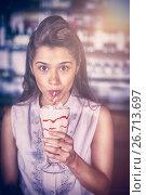 Купить «Woman drinking smoothie at restaurant», фото № 26713697, снято 10 июля 2020 г. (c) Wavebreak Media / Фотобанк Лори