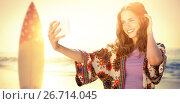 Купить «Composite image of smiling girl taking a selfie», фото № 26714045, снято 26 июня 2019 г. (c) Wavebreak Media / Фотобанк Лори
