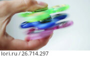 Купить «hand playing with three spinning fidget spinners», видеоролик № 26714297, снято 15 октября 2019 г. (c) Syda Productions / Фотобанк Лори
