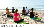 Купить «Back view of sporty people meditating in yoga position Padmasana on beach», видеоролик № 26717297, снято 22 июня 2017 г. (c) Яков Филимонов / Фотобанк Лори