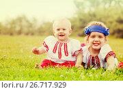 Купить «children in russian folk clothes on grass», фото № 26717929, снято 15 июня 2013 г. (c) Яков Филимонов / Фотобанк Лори