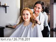 Купить «Woman very much likes her fashionable hairdress in hairdressing salon», фото № 26718201, снято 7 марта 2017 г. (c) Яков Филимонов / Фотобанк Лори