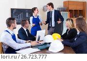 Купить «Team of architects working at office», фото № 26723777, снято 7 декабря 2019 г. (c) Яков Филимонов / Фотобанк Лори