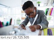 Купить «Businessman writing on paper at desk», фото № 26725505, снято 13 апреля 2017 г. (c) Wavebreak Media / Фотобанк Лори