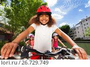 Купить «Cute girl riding bike along the river embankment», фото № 26729749, снято 21 мая 2017 г. (c) Сергей Новиков / Фотобанк Лори