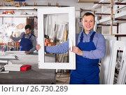 Купить «vigorous professional labours with finished PVC profiles and windows», фото № 26730289, снято 30 марта 2017 г. (c) Яков Филимонов / Фотобанк Лори