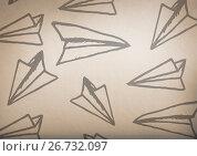 paper airplane graphics with rustic background. Стоковая иллюстрация, агентство Wavebreak Media / Фотобанк Лори