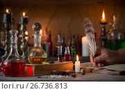 Купить «hand, magic potion, ancient books and candles», фото № 26736813, снято 4 августа 2017 г. (c) Майя Крученкова / Фотобанк Лори