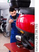 Купить «diligent male worker working at restoring motorbike in workshop», фото № 26738793, снято 16 октября 2018 г. (c) Яков Филимонов / Фотобанк Лори