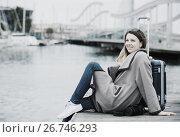 Купить «Female tourist standing at pier», фото № 26746293, снято 27 марта 2017 г. (c) Яков Филимонов / Фотобанк Лори