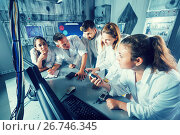 Купить «Five adults solving conundrums together in quest room in view as abandoned lab», фото № 26746345, снято 6 июля 2017 г. (c) Яков Филимонов / Фотобанк Лори