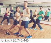 Купить «Adults dancing bachata together», фото № 26746445, снято 17 ноября 2018 г. (c) Яков Филимонов / Фотобанк Лори