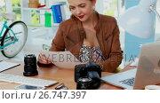Купить «Female executive reviewing captured photograph at her desk 4k», видеоролик № 26747397, снято 21 ноября 2018 г. (c) Wavebreak Media / Фотобанк Лори