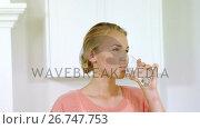 Portrait of smiling woman drinking water. Стоковое видео, агентство Wavebreak Media / Фотобанк Лори