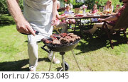 Купить «man cooking meat on barbecue grill at summer party», видеоролик № 26753045, снято 20 июля 2019 г. (c) Syda Productions / Фотобанк Лори