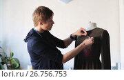 Купить «fashion designer with dummy making dress at studio», видеоролик № 26756753, снято 20 июля 2019 г. (c) Syda Productions / Фотобанк Лори