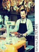 Купить «Male seller weighing on scales piece of meat», фото № 26757401, снято 2 января 2017 г. (c) Яков Филимонов / Фотобанк Лори