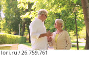 Купить «happy senior couple talking at summer city park», видеоролик № 26759761, снято 19 июня 2019 г. (c) Syda Productions / Фотобанк Лори