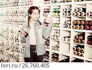 Купить «Portrait of girl choosing paint color in aerosol can in art shop», фото № 26760405, снято 12 апреля 2017 г. (c) Яков Филимонов / Фотобанк Лори