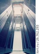 Купить «Racks in the data center», фото № 26762293, снято 22 июля 2018 г. (c) Mikhail Starodubov / Фотобанк Лори