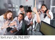 Купить «Guys and girls having fun in escape room», фото № 26762897, снято 6 июля 2017 г. (c) Яков Филимонов / Фотобанк Лори