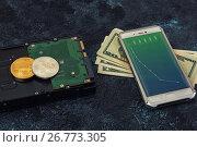 Купить «Bitcoin coin with HDD money and smartphone», фото № 26773305, снято 16 августа 2017 г. (c) Jan Jack Russo Media / Фотобанк Лори
