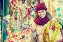 Beautiful happy woman choosing Christmas decoration, фото № 26773785, снято 22 августа 2017 г. (c) Яков Филимонов / Фотобанк Лори
