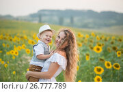 Mother with baby son in sunflower field. Стоковое фото, фотограф Кирилл Греков / Фотобанк Лори
