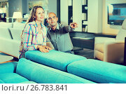 Купить «Married couple looking for new stylish sofa», фото № 26783841, снято 16 мая 2017 г. (c) Яков Филимонов / Фотобанк Лори