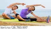 Купить «Young couple training yoga poses sitting on beach», фото № 26783997, снято 7 апреля 2020 г. (c) Яков Филимонов / Фотобанк Лори