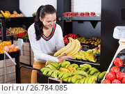 Купить «Woman choosing fruits in grocery shop», фото № 26784085, снято 23 ноября 2016 г. (c) Яков Филимонов / Фотобанк Лори