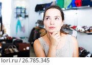 Купить «Female customer in shoes center», фото № 26785345, снято 26 сентября 2016 г. (c) Яков Филимонов / Фотобанк Лори