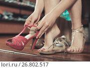 Купить «Female customer is sitting and gonna to trying on shoes», фото № 26802517, снято 10 мая 2017 г. (c) Яков Филимонов / Фотобанк Лори