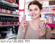 Купить «female customer looking for lipstick in cosmetics shop», фото № 26802701, снято 21 февраля 2017 г. (c) Яков Филимонов / Фотобанк Лори