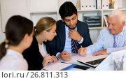 Купить «Employees are writing financial reports and discussing with mature boss in the office.», видеоролик № 26811313, снято 2 июля 2017 г. (c) Яков Филимонов / Фотобанк Лори