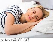 Купить «Young woman sleeping tight in bed», фото № 26811429, снято 17 ноября 2019 г. (c) Яков Филимонов / Фотобанк Лори