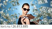 Купить «happy woman in black sunglasses with shopping bags», фото № 26813885, снято 9 апреля 2016 г. (c) Syda Productions / Фотобанк Лори