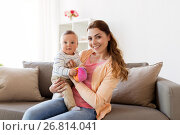 Купить «happy young mother with little baby at home», фото № 26814041, снято 19 мая 2017 г. (c) Syda Productions / Фотобанк Лори