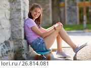 Купить «happy teenage girl sitting on longboard on street», фото № 26814081, снято 17 июня 2017 г. (c) Syda Productions / Фотобанк Лори
