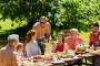 happy family having dinner or summer garden party, фото № 26814149, снято 9 июля 2017 г. (c) Syda Productions / Фотобанк Лори