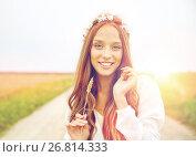 Купить «smiling young hippie woman on cereal field», фото № 26814333, снято 27 августа 2015 г. (c) Syda Productions / Фотобанк Лори