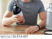 Купить «close up of man with protein shake bottle and jar», фото № 26814497, снято 14 мая 2015 г. (c) Syda Productions / Фотобанк Лори