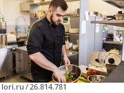 Купить «chef cook making food at restaurant kitchen», фото № 26814781, снято 2 апреля 2017 г. (c) Syda Productions / Фотобанк Лори