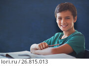 Купить «Composite image of portrait of boy doing homework», фото № 26815013, снято 8 апреля 2020 г. (c) Wavebreak Media / Фотобанк Лори