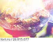 Купить «meat cooking on barbecue grill at summer party», фото № 26815077, снято 28 августа 2016 г. (c) Syda Productions / Фотобанк Лори